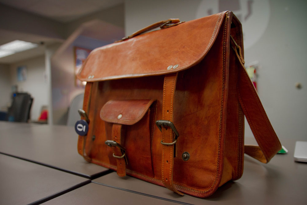 belongings leather bag traint travel indonesia