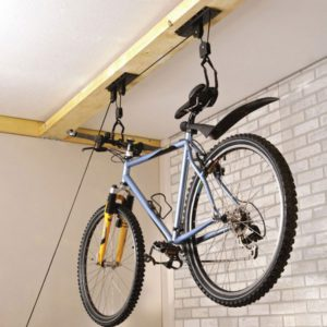 By hanging your bike to the ceiling, you can add a unique touch to your room and save many spaces