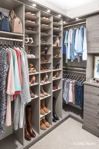 walk-in closet organized by item's type