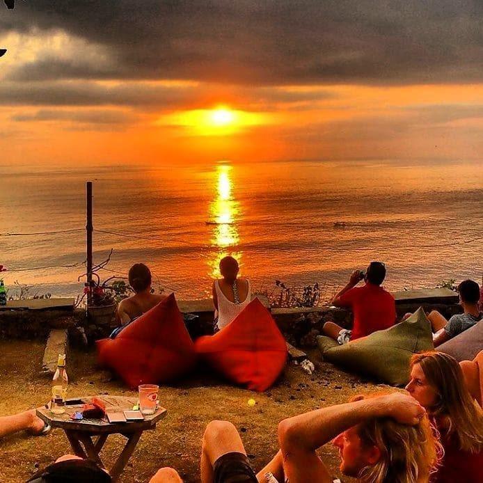 enjoying the sunset in uluwatu