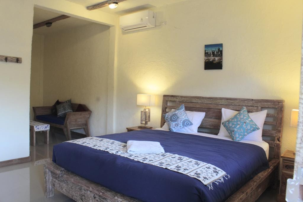 Adore guesthouse room and bed in East Bali